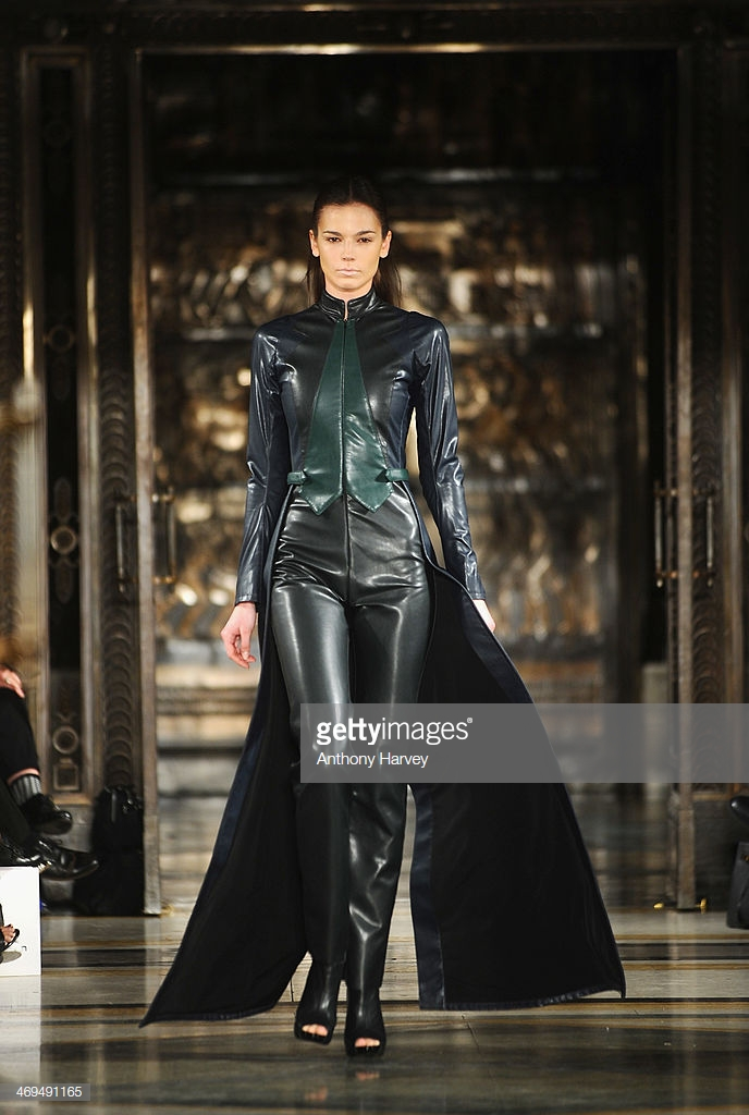 LONDON, ENGLAND - FEBRUARY 15:  A model walks the runway at the Bernard Chandran show at the Fashion Scout venue during London Fashion Week AW14 at Freemasons Hall on February 15, 2014 in London, England.  (Photo by Anthony Harvey/Getty Images)